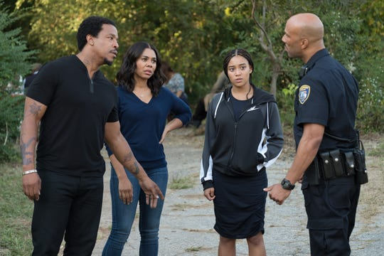 """Maverick (Russell Hornsby, from left), Lisa (Regina Hall) and Starr (Amandla Stenberg) have a discussion with Carlos (Common) in """"The Hate U Give."""""""