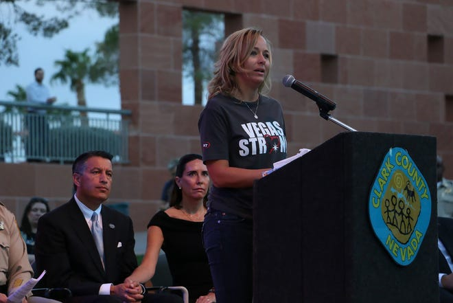 Mynda Smith talks to hundreds gathered for the 1 October Sunrise Remembrance at the Clark County (Nevada) Government Center Amphitheater in Las Vegas on Monday, Oct. 1, 2018. The ceremony marked the first anniversary of the mass shooting in Las Vegas that took 58 lives.