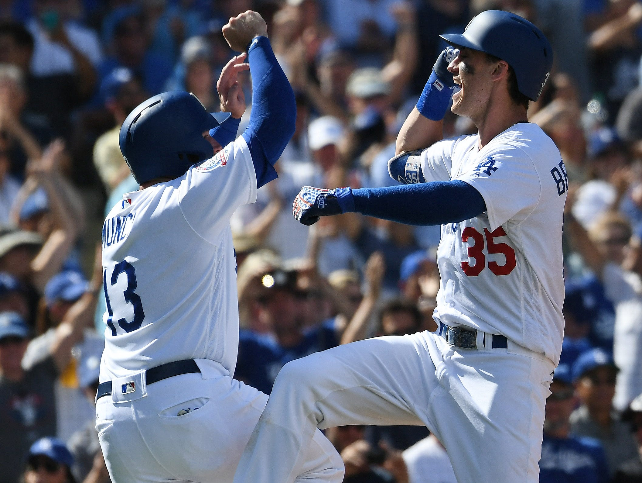 Cody Bellinger celebrates his two-run homer with teammate Max Muncy.