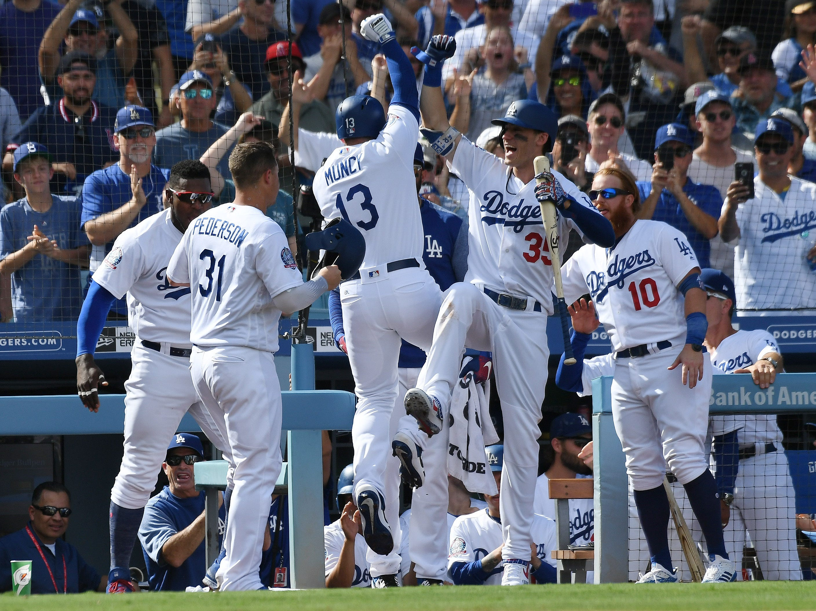 Dodgers players celebrate Max Muncy's two-run homer in the fifth inning.