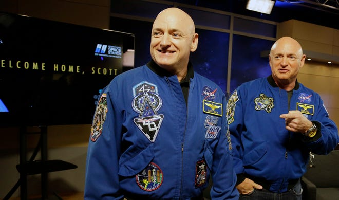 Two astronauts in one family!  NASA astronaut Scott Kelly, left, and his twin Mark get together before a press conference, March 4, 2016, in Houston. Scott Kelly set a U.S. record with his a 340-day mission to the International Space Station.  Mark is the husband of former Congresswoman Gabrielle Giffords, and is an author, political activist, and aerospace consultant.