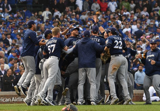 The Milwaukee Brewers celebrate on Wrigley Field after knocking off the Cubs to clinch the division.