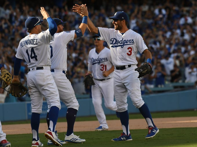 Dodgers players celebrate after the 5-2 win.