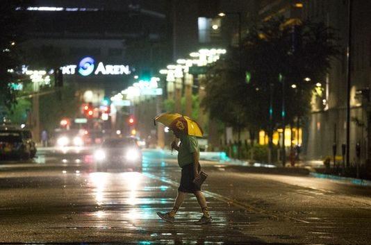 A pedestrian crosses a street in downtown Phoenix on Sept. 30, 2018.