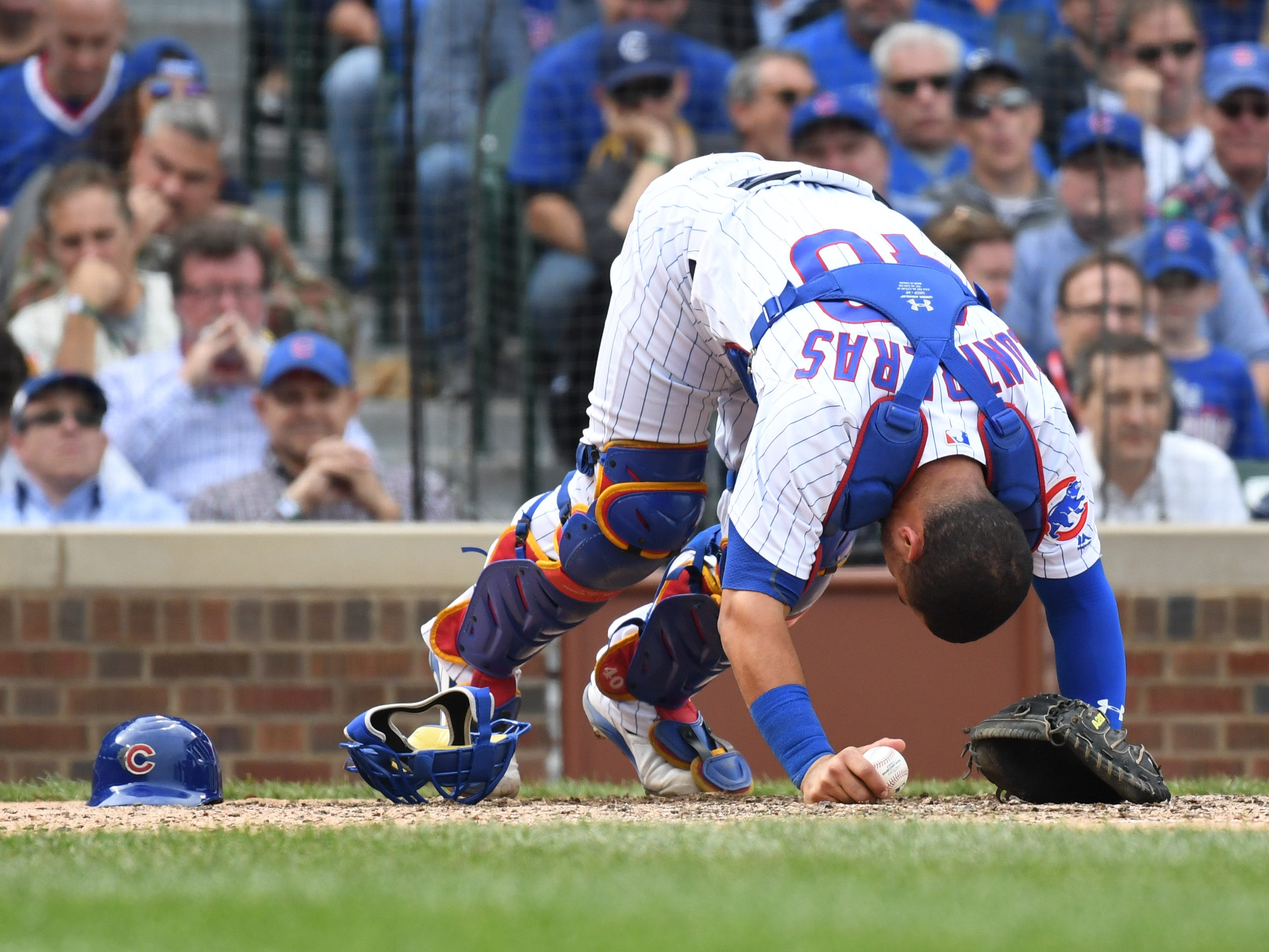 Cubs catcher Willson Contreras reacts after  getting hit by a pitch in the eighth inning.