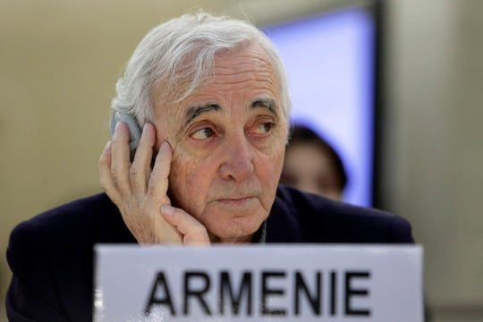 Armenia's ambassador to Switzerland, Armenian-French singer Charles Aznavour listens to a speech during a Human Rights Council at the European headquarters of the United Nations in Geneva, Switzerland, January 27, 2010.