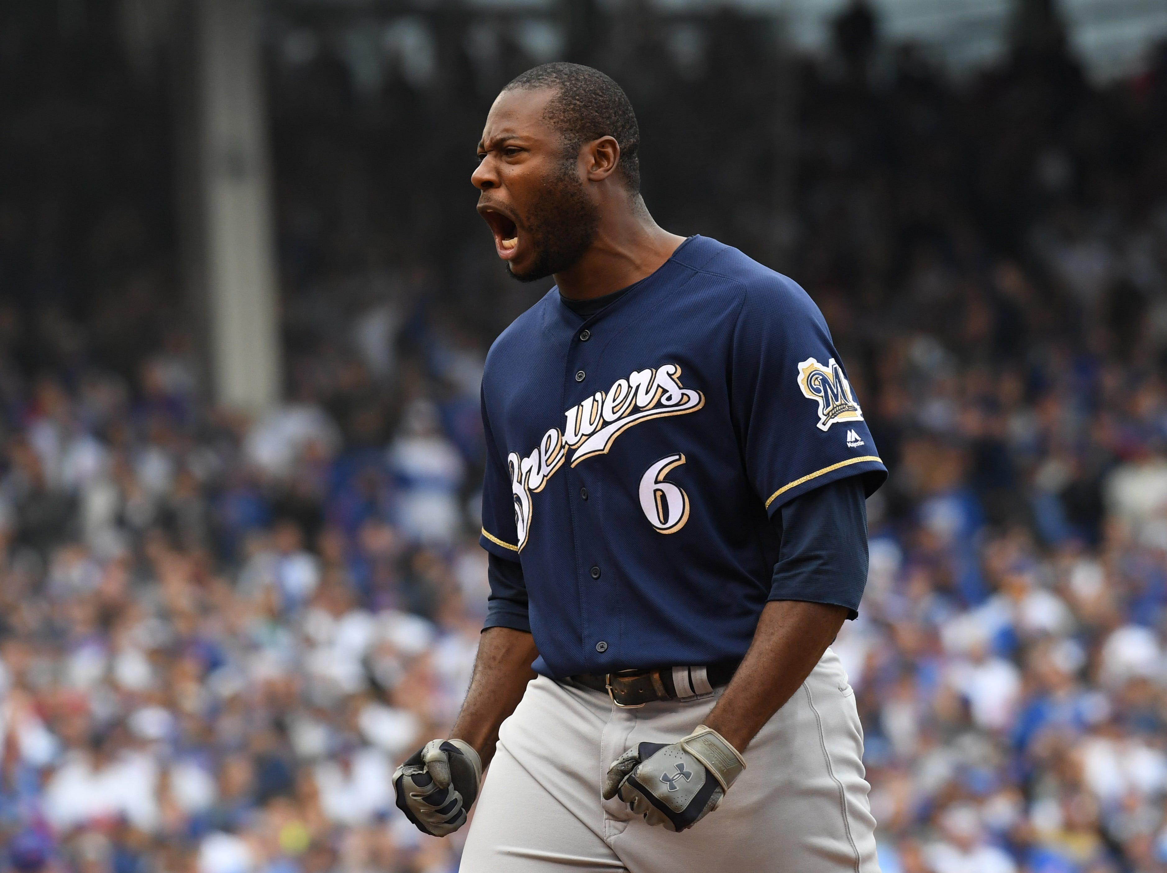 Lorenzo Cain celebrates after his go-ahead RBI single in the eighth inning.