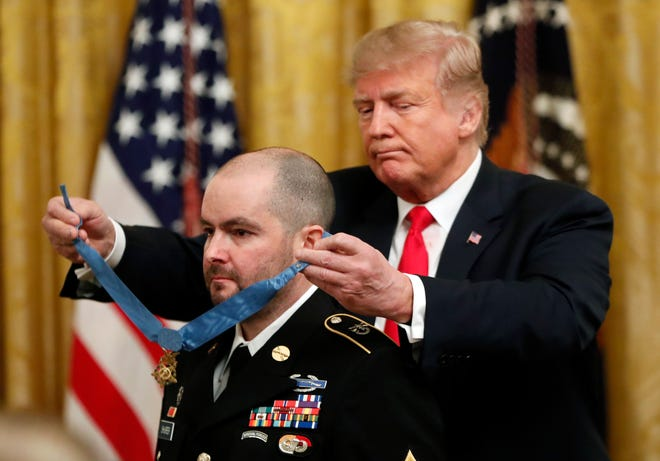 President Donald Trump awards the Medal of Honor to former Army Staff Sgt. Ronald J. Shurer II for actions in Afghanistan.
