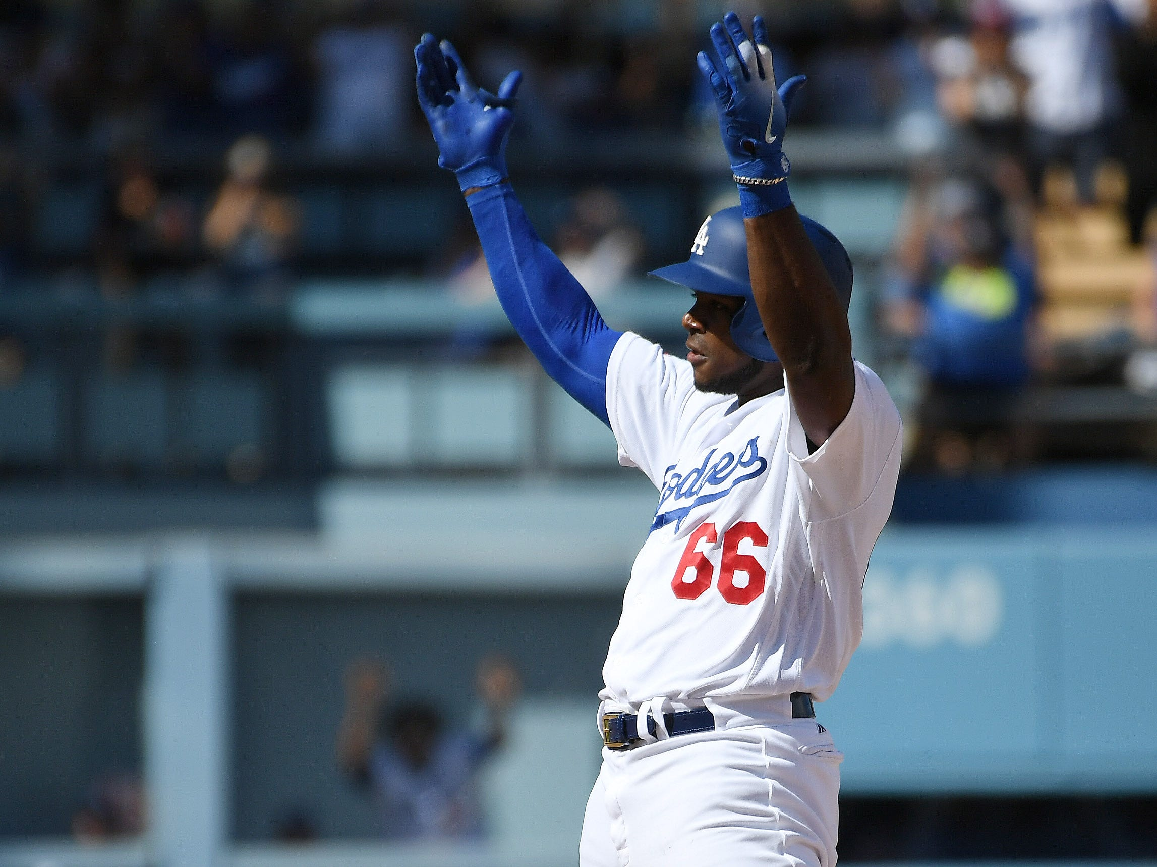 Dodgers right fielder Yasiel Puig reacts after hitting a double in the fourth inning.