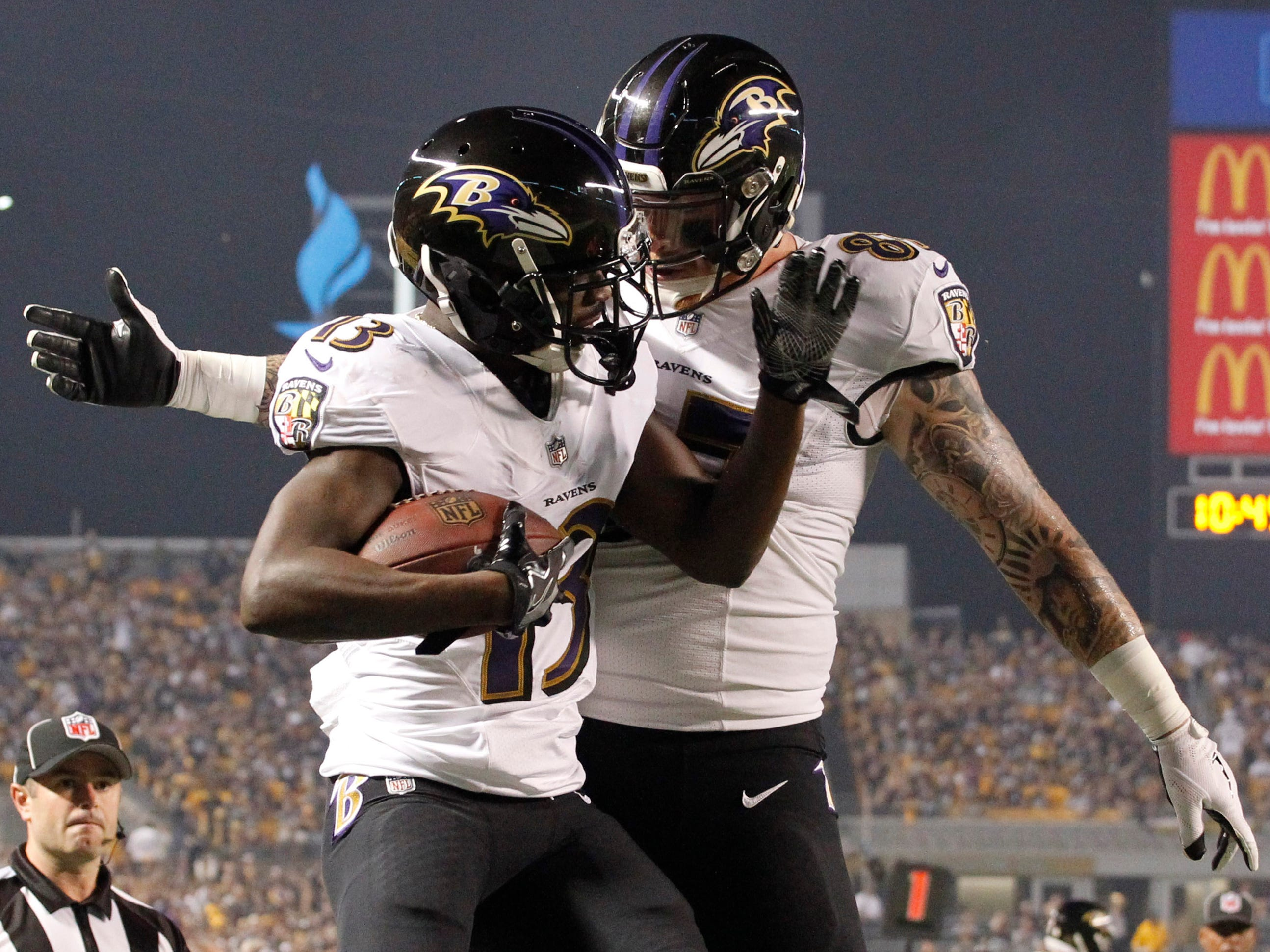 Baltimore Ravens wide receiver John Brown (13) celebrates his touchdown catch with teammate Maxx Williams during the first quarter against the Pittsburgh Steelers at Heinz Field.