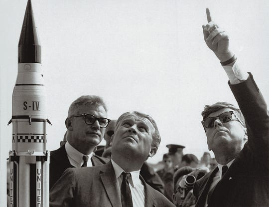 NASA Administrator Robert C. Seamans Jr. (L) and  scientist Wernher Von Braun (C), father of the Saturn V Rocket which took the US astronauts to the Moon, are seen with President John F. Kennedy (R) at a Cape Canaveral launching pad on Nov. 1, 1963.
