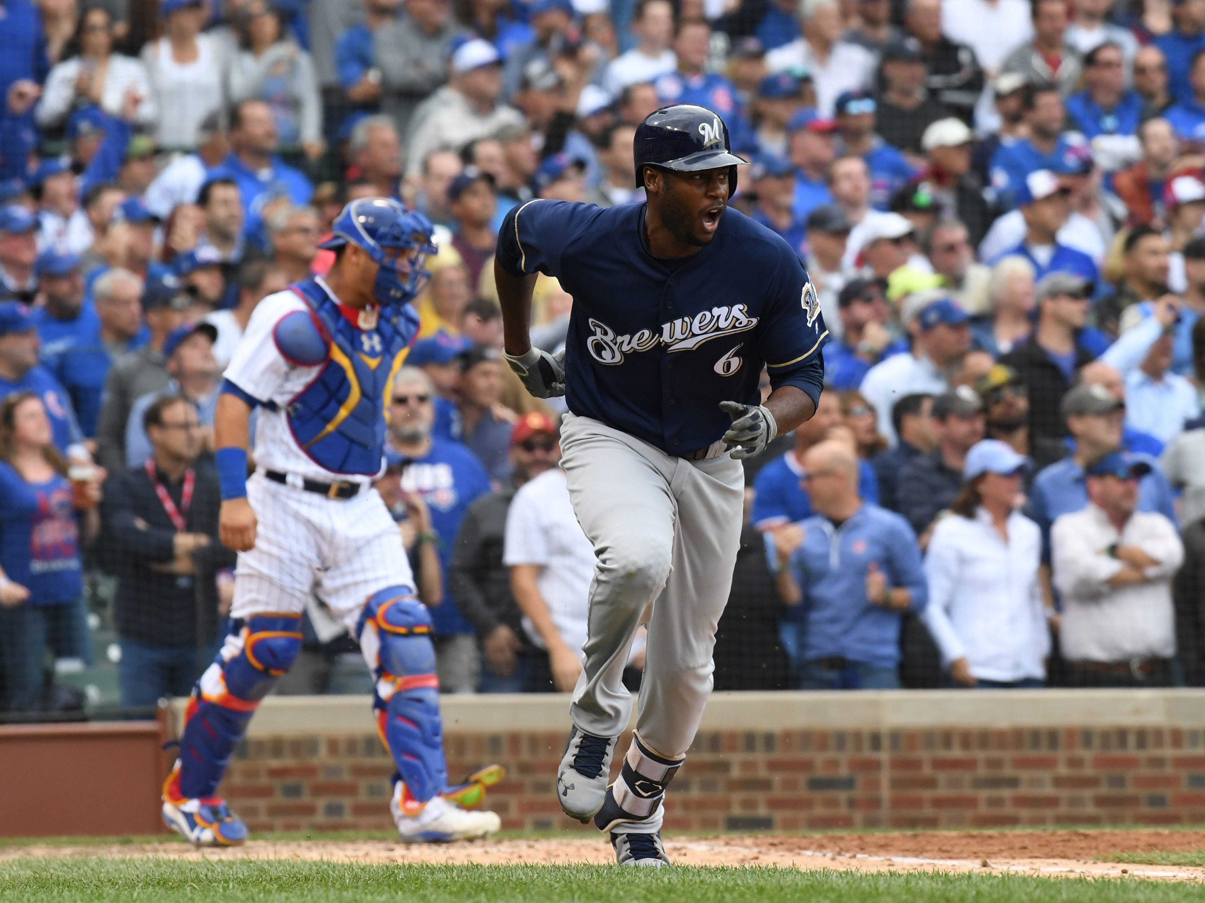 Brewers center fielder Lorenzo Cain  hits an RBI single in the eighth inning to put his team ahead.