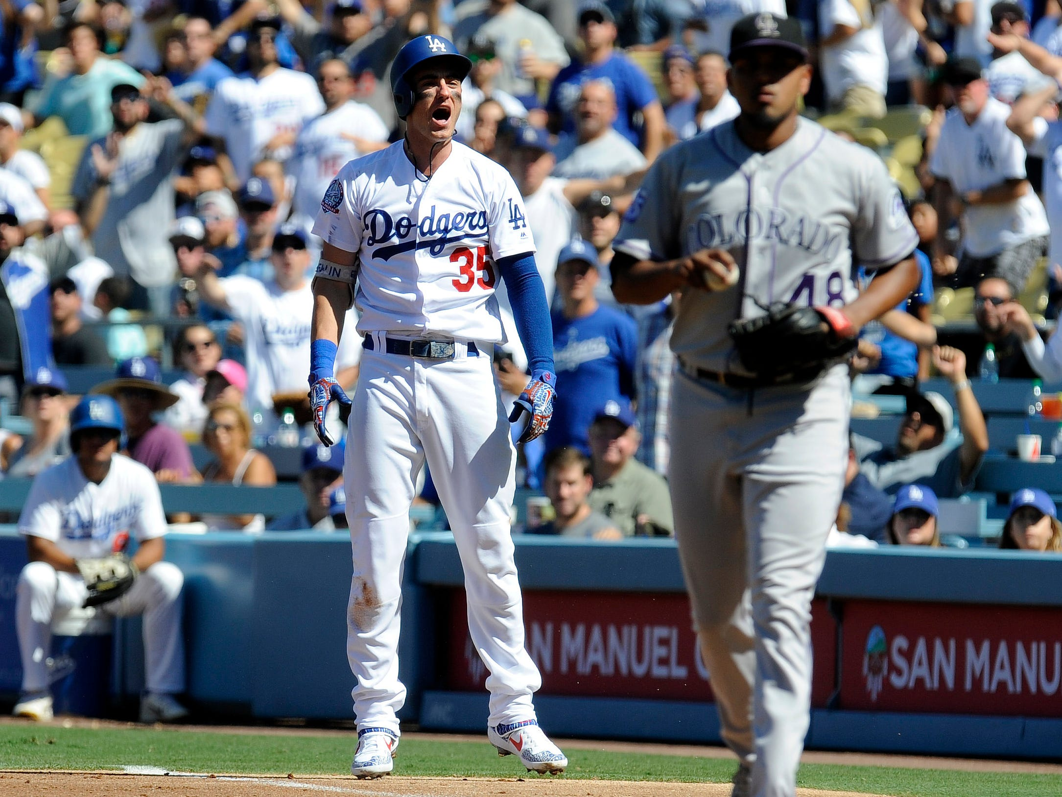 Dodgers center fielder Cody Bellinger (35) reacts after being called out at first base in the second inning.