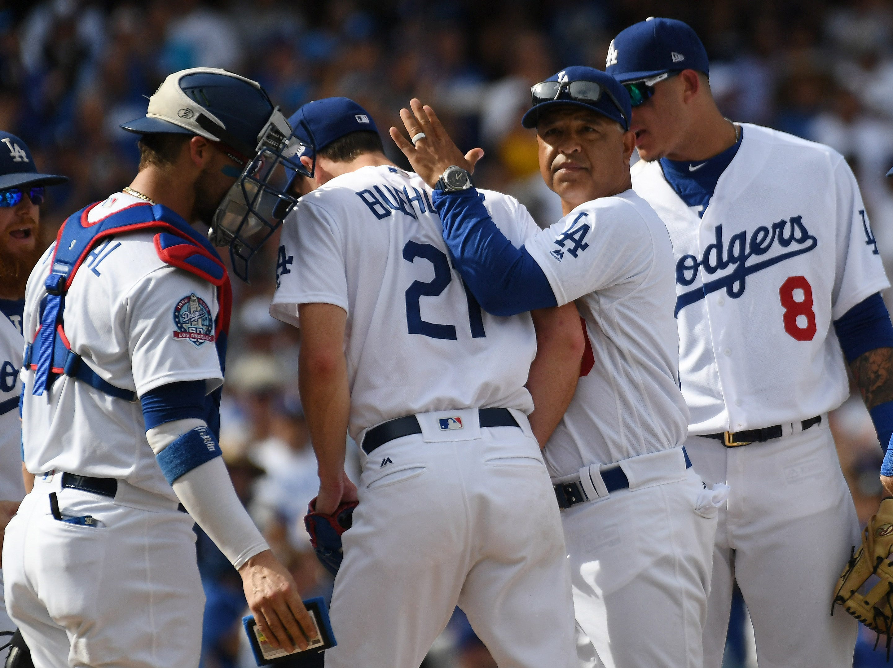 Dodgers starter Walker Buehler comes out of the game in the seventh inning.