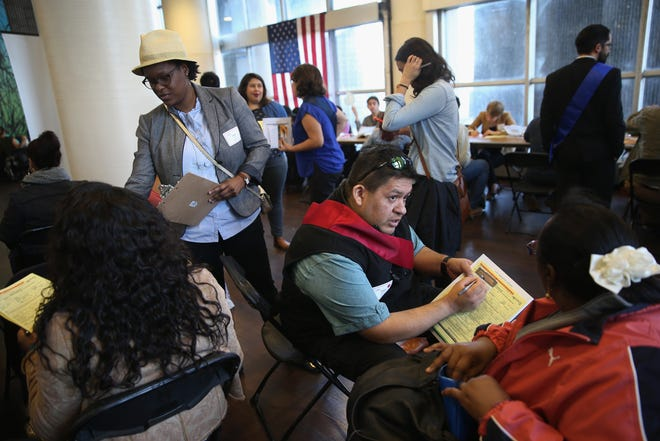 Volunteers assist immigrants with U.S. citizenship applications at a Citizenship Now! event held by the City University of New York (CUNY), on March 12, 2016, in the Bronx borough of New York City.
