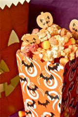 Monster munch popcorn is sure to be a hit at your Halloween soiree.
