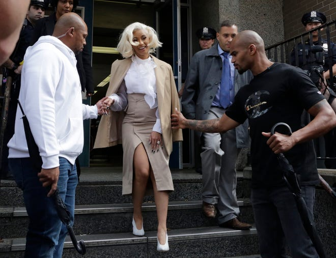 Cardi B leaves a New York police precinct, Oct. 1, 2018, in Queens after she was arrested and charged with endangerment and assault in connection with a fight at a strip club on Aug. 29.