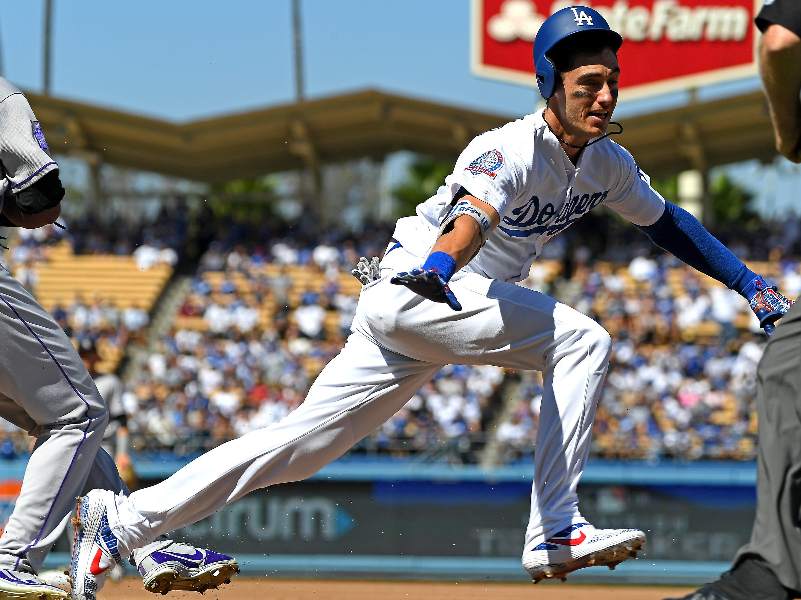 Cody Bellinger is called out at first base in the third inning.