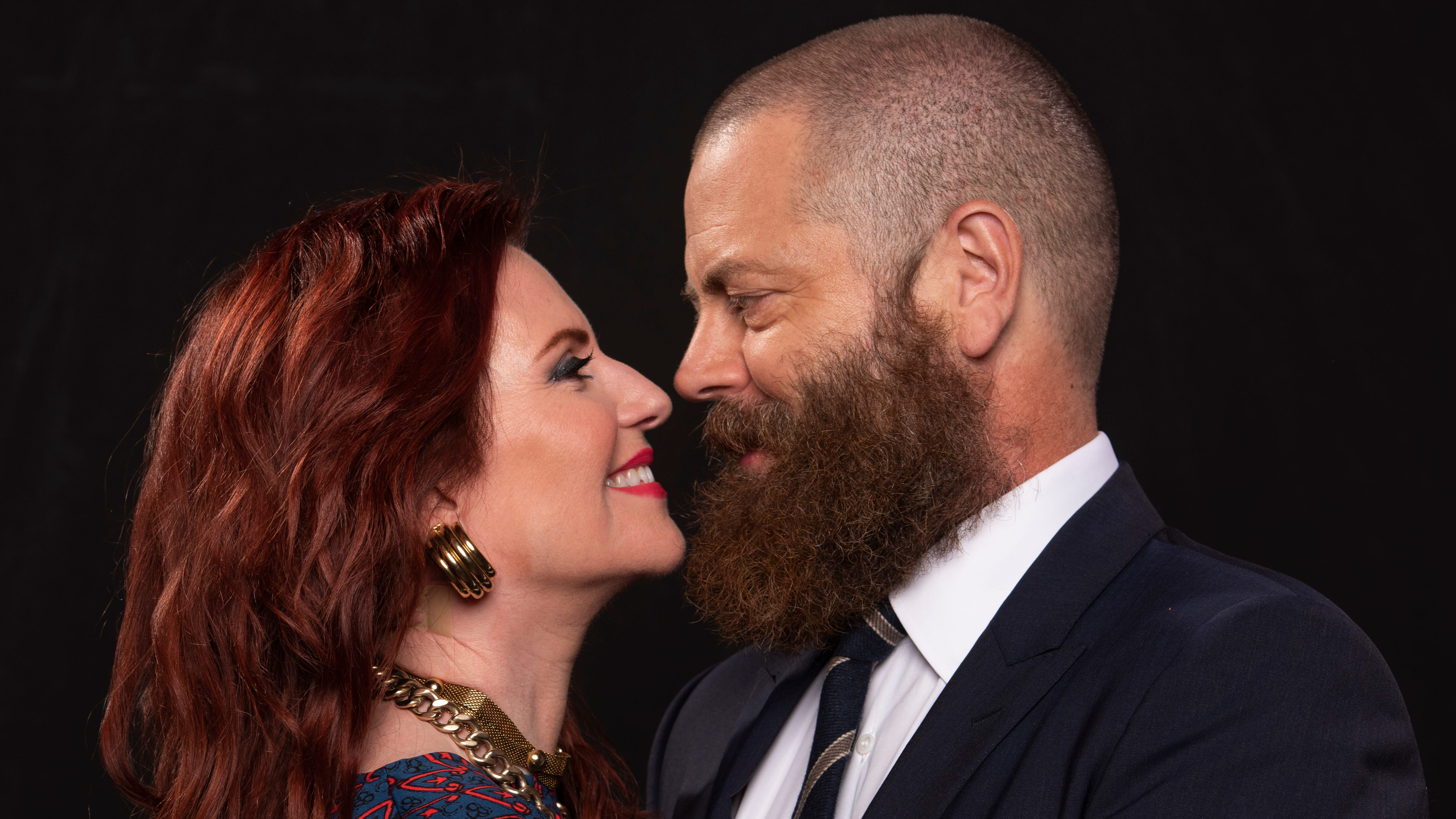 Actors Megan Mullally and Nick Offerman get close in New York on Oct. 1, 2018. The couple have written a funny book about their marriage and lives.