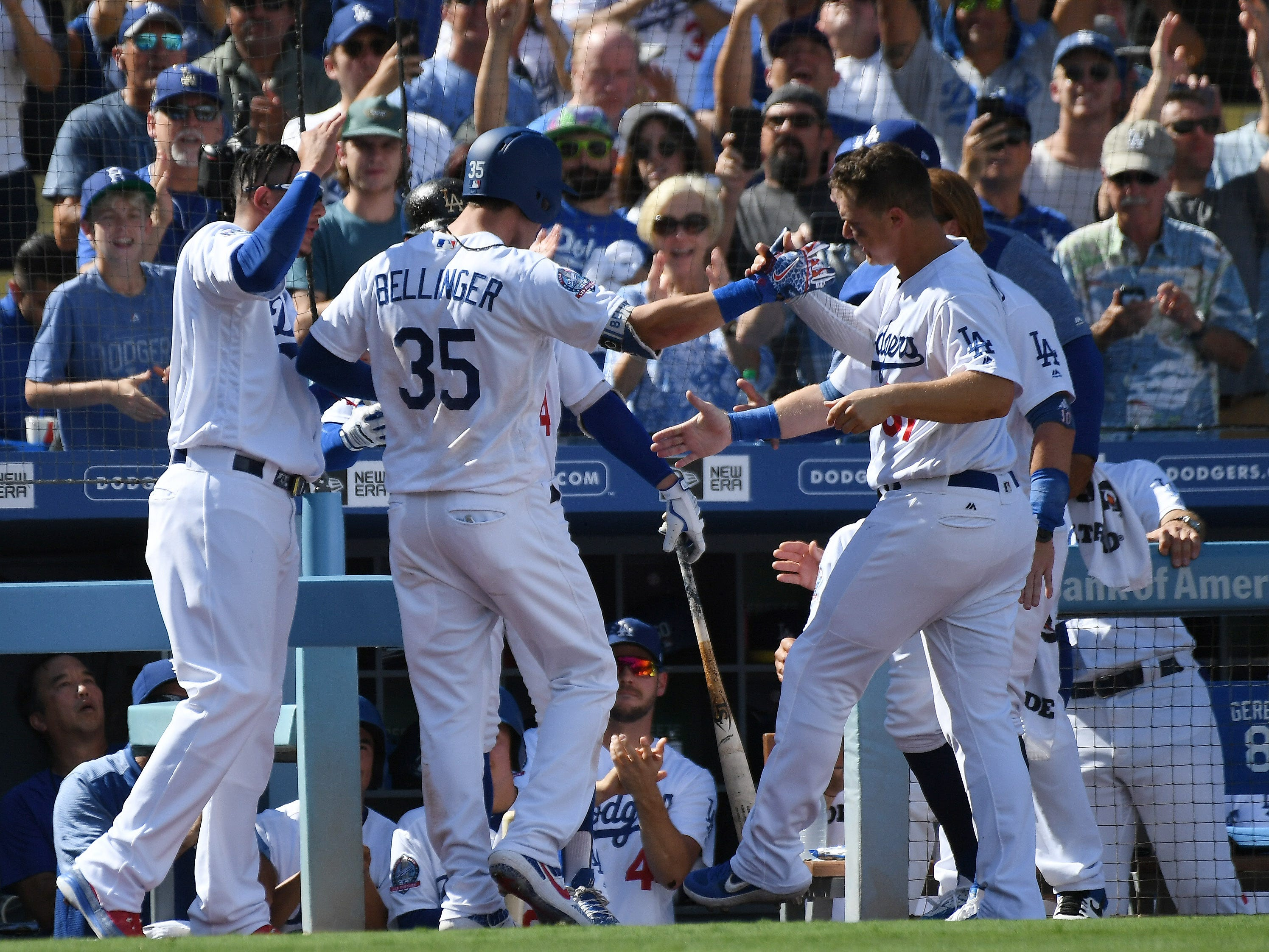 Dodgers players celebrate Cody Bellinger's two-run homer in the fourth inning.