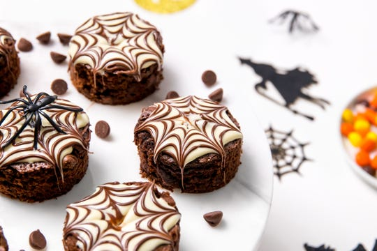 These spooky brownies are Halloween themed with spider web frosting.