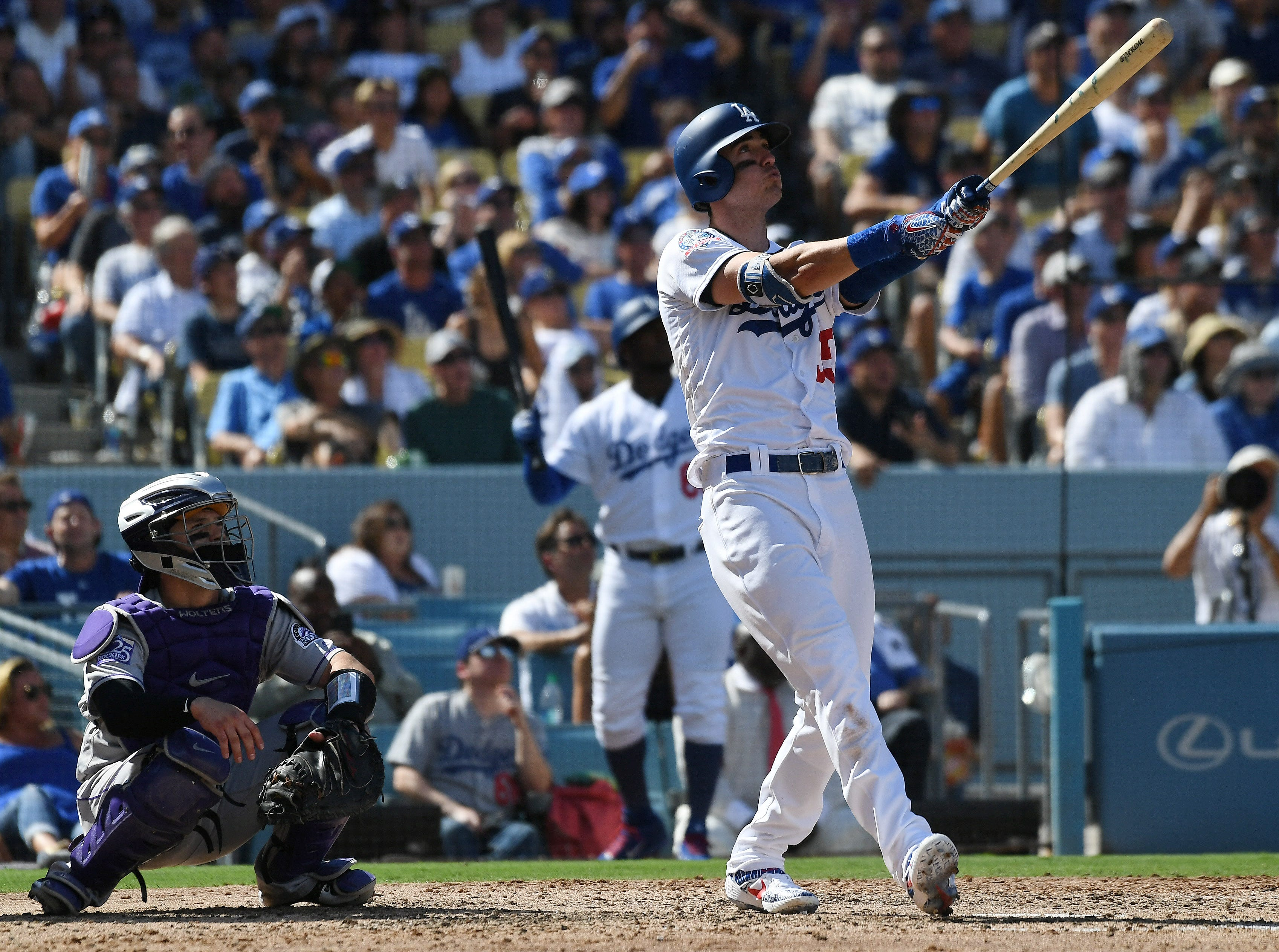 Dodgers center fielder Cody Bellinger hits a two-run homer in the fourth inning.
