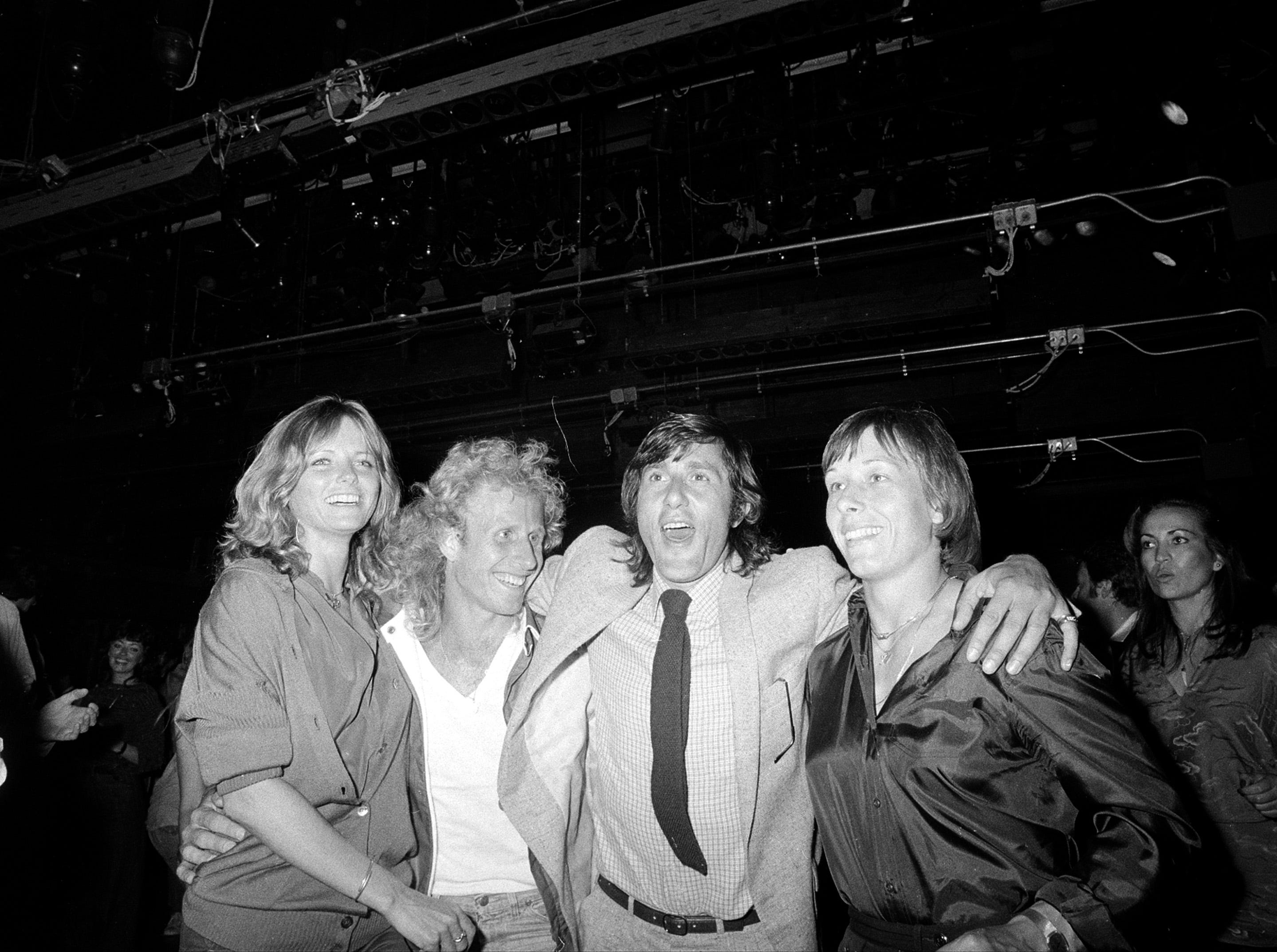 Fashion model Cheryl Tiegs, left, poses with tennis players Vitas Gerulaitis, second from left, Ilie Nastase, and Martina Navratilova at Studio 54 nightclub on Sept. 10, 1979.