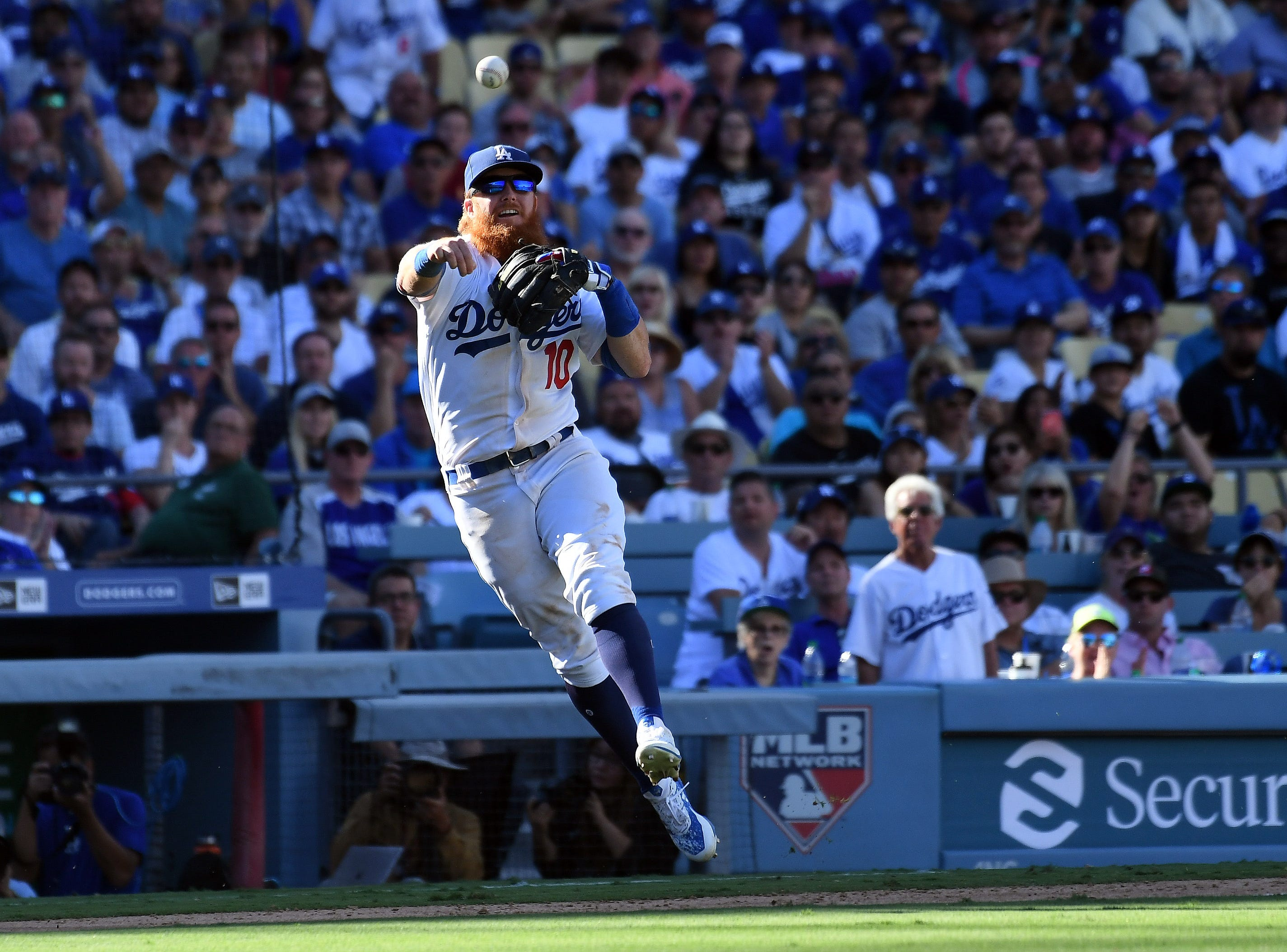 Dodgers third baseman Justin Turner throws to first in the eighth inning.