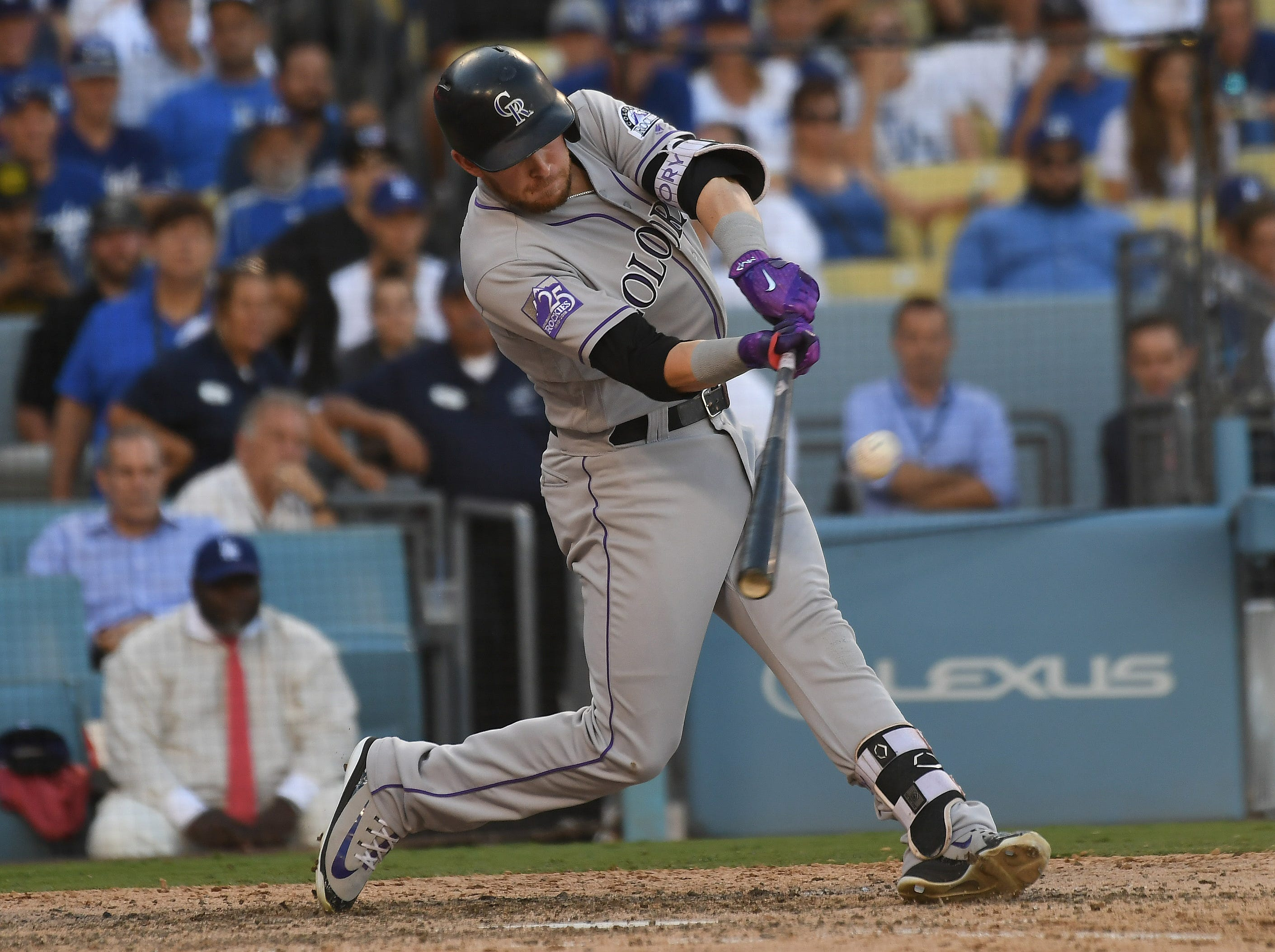 Rockies shortstop Trevor Story connects on a solo homer in the ninth inning.