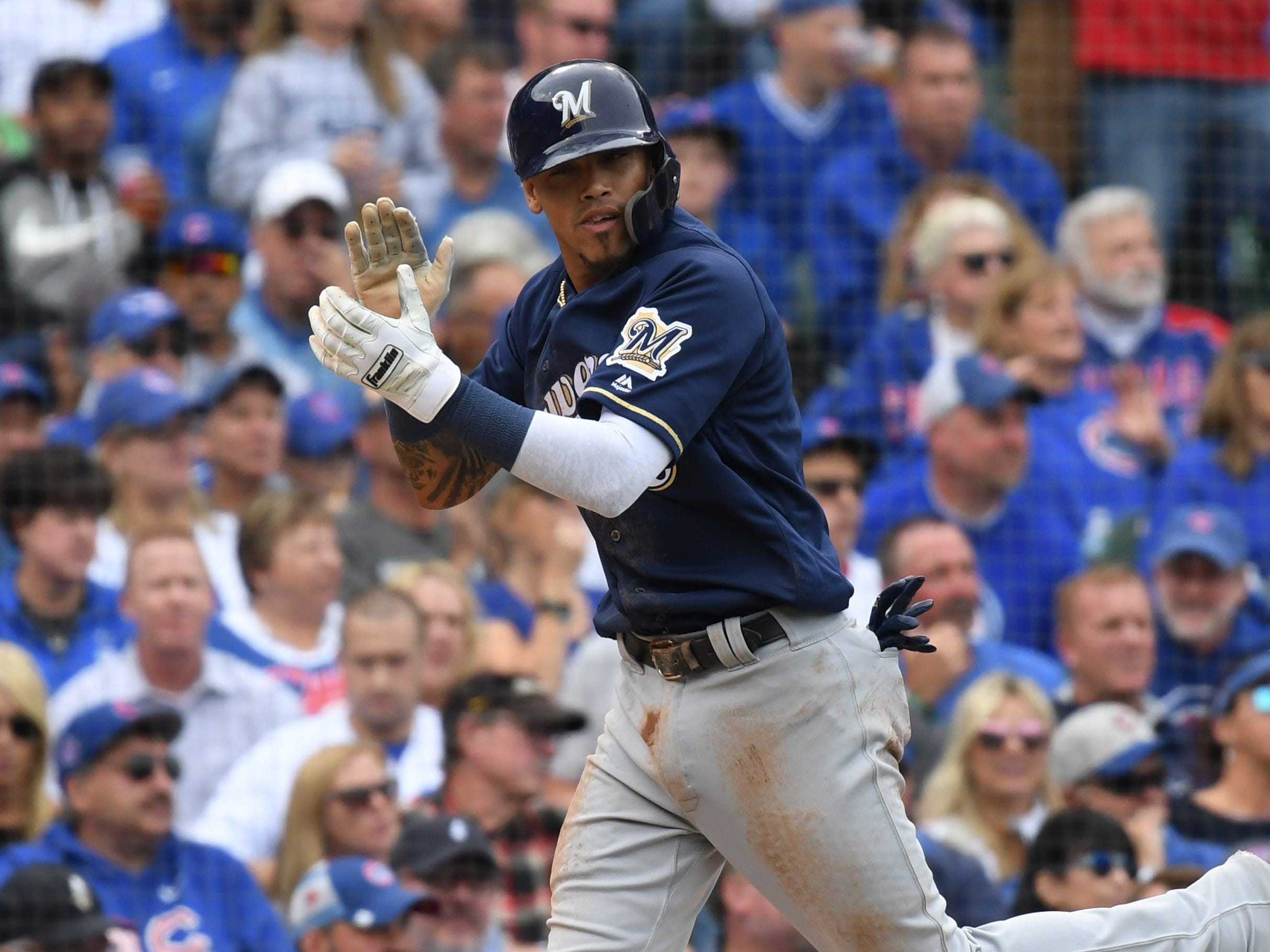 Brewers shortstop Orlando Arcia scores on Christian Yelich's single in the third inning.