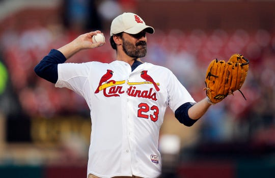 St. Louis native Jon Hamm throws out a ceremonial first pitch before a Cardinals game in 2014.