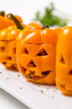 Celebrate with these spooky stuffed peppers.