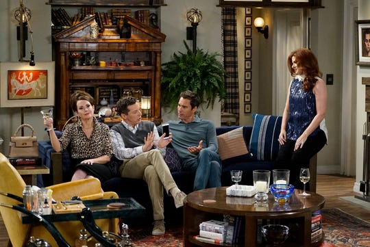 """Gang's all here: Karen (Megan Mullally), Jack (Sean Hayes), Will (Eric McCormack) and Grace (Debra Messing) crowd a familiar apartment in Episode 1 of Season 9, """"Eleven Years Later."""""""