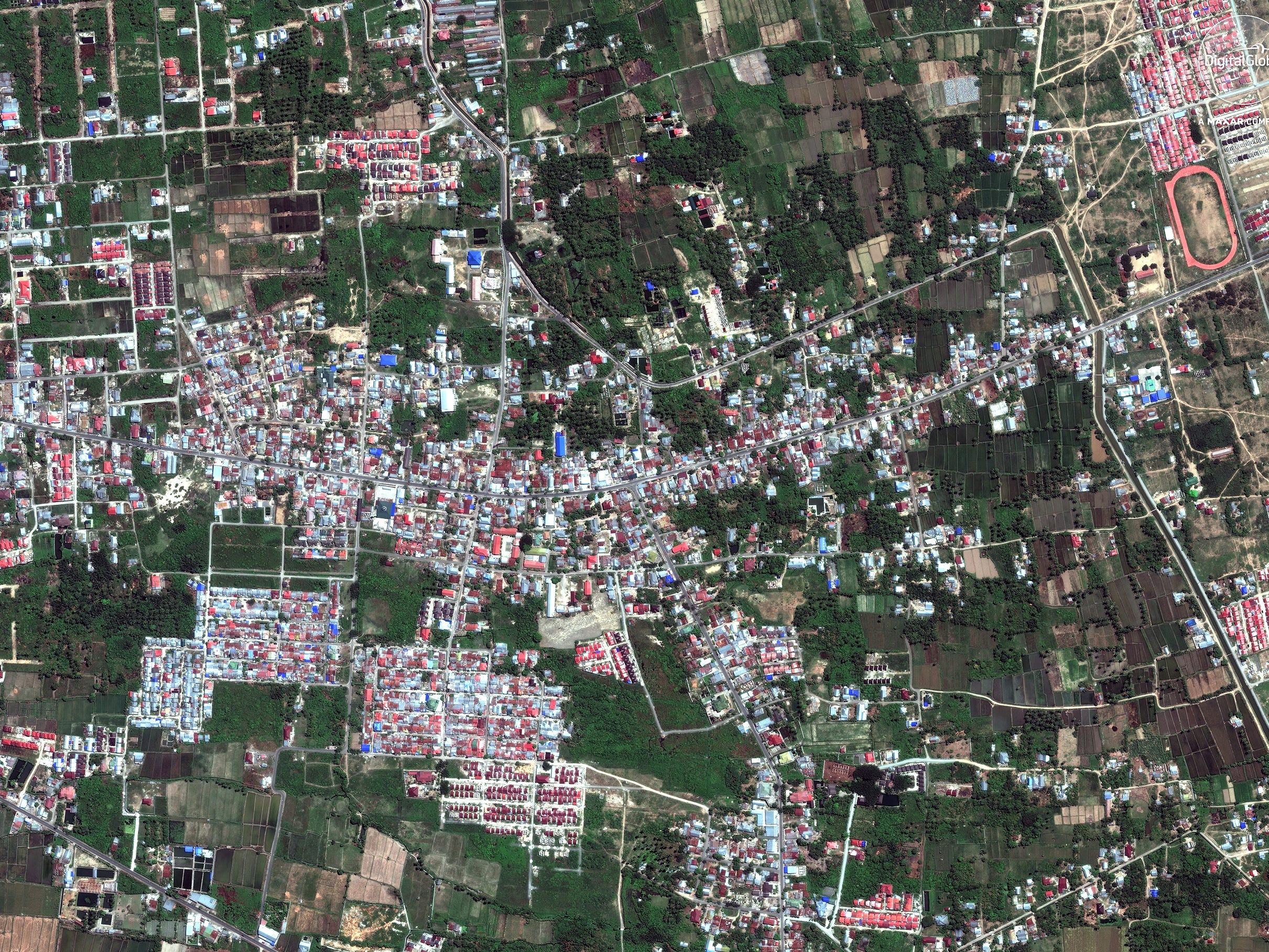 A satellite photo made available by DigitalGlobe shows Petobo, Palu, central Sulawesi, Indonesia, Aug. 17, 2018, before a tsunami hit the area.
