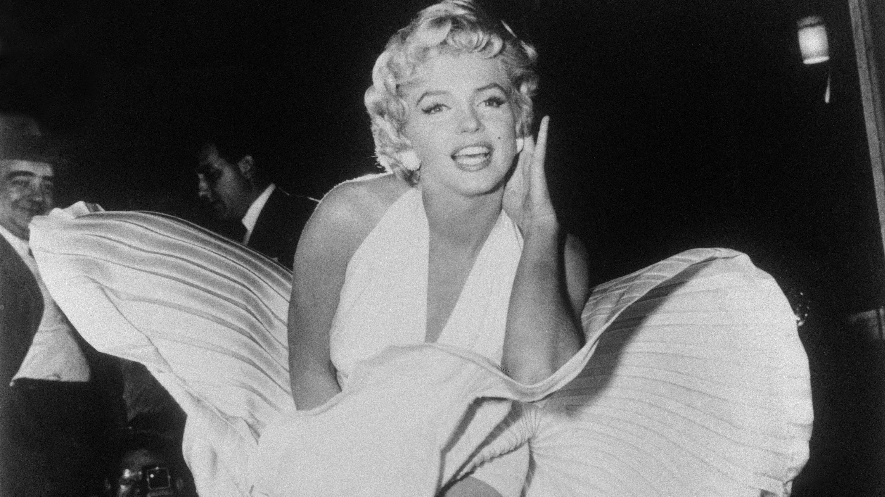 marilyn monroe auction featuring iconic white dress earns 1 6m