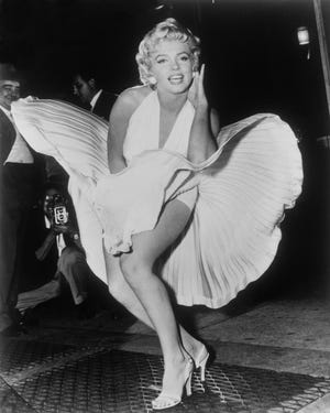 """FILE - In this Sept. 9, 1954 file photo, Marilyn Monroe poses over the updraft of a New York subway grate while filming """"The Seven Year Itch"""" New York. The dress, created by Bill Travilla, is one of several items that will be up for auction in October 2018. (AP Photo/Matty Zimmerman) ORG XMIT: NYET361"""