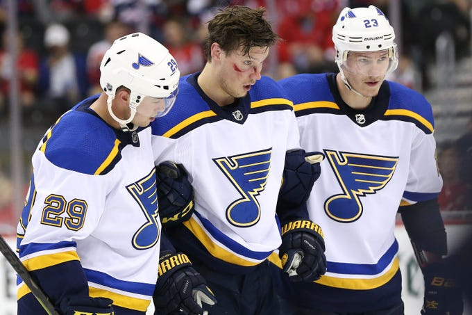 Sept. 30: Bloodied St. Louis Blues center Oskar Sundqvist is helped off the ice after a check by Washington Capitals right wing Tom Wilson.