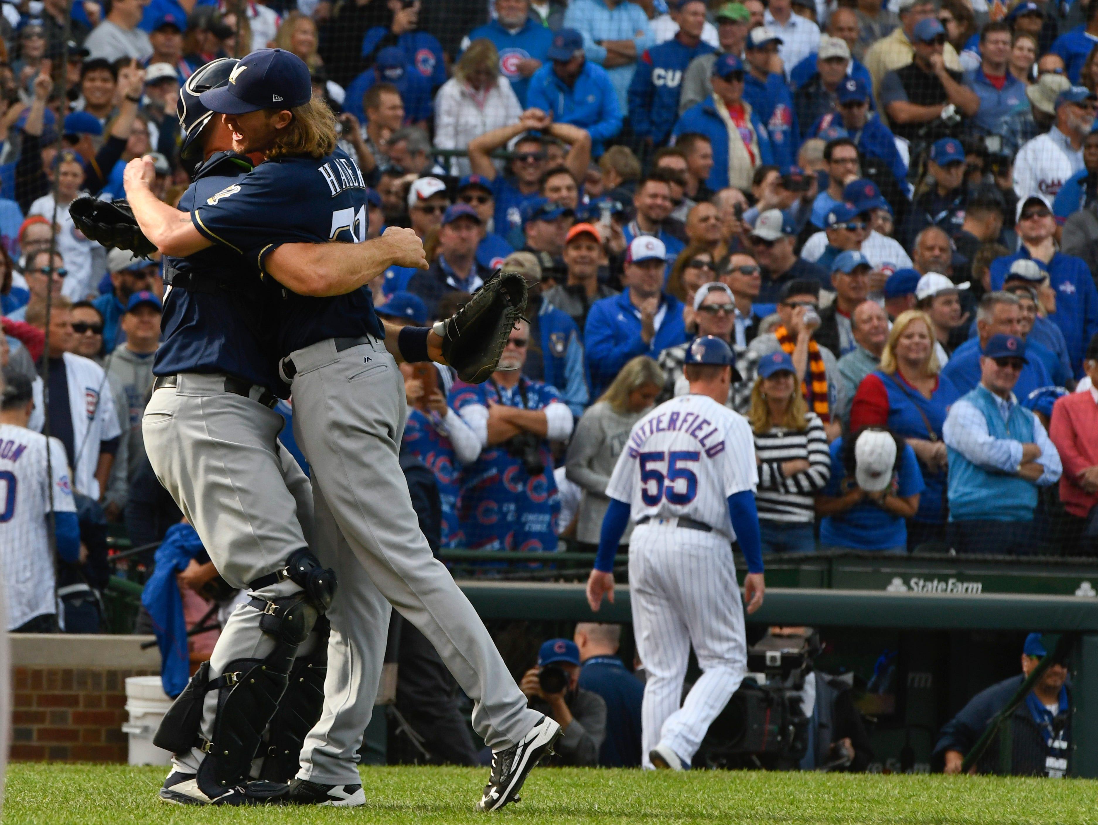 Brewers reliever Josh Hader hugs catcher Erik Kratz after the final out.