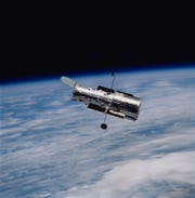 The fourth Hubble Telescope servicing mission, returned to Earth, in 2002, after the crew performed five spacewalks to install solar arrays, a camera, a power control unit, a reaction wheel assembly and an experimental cooling system. NASA's Marshall Space Flight Center designed, developed and built the telescope, which launched and was deployed in April 1990.