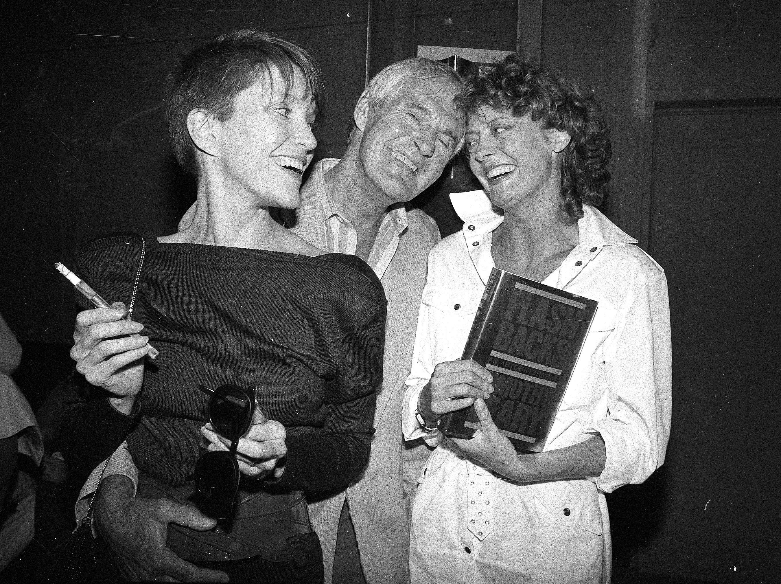 "Timothy Leary, center, poses with his wife Barbara, left, and friend Susan Sarandon during a Studio 54 party on June 8, 1983. The party was to announce the publication of Leary's autobiography called, ""Flashbacks."""