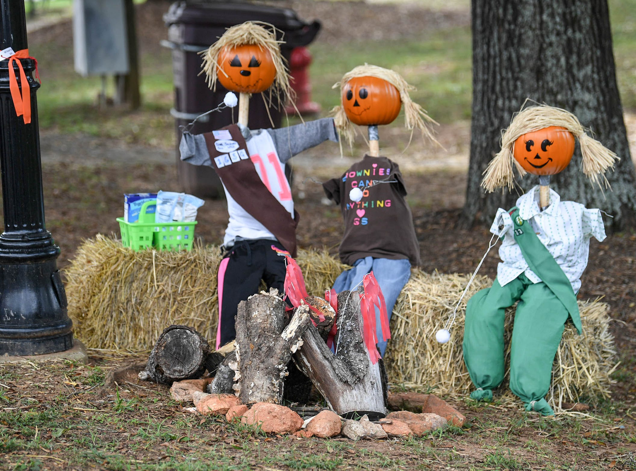 Brownie and Girls Scout scarecrows at a campfire is one of many in The Pendleton Scarecrow Contest leading up to the 20th Fall Harvest Festival in the village green Saturday, October 6 from 10 a.m. to 5 p.m. The annual contest in Pendleton for businesses, individuals, groups, organizations and churches who create fun not scary Scarecrows. People driving around the downtown square can see different theme scarecrows.