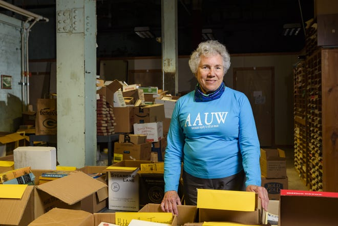 Appleton's Connie Polley works in the sorting room for the American Association of University Women's book sale.