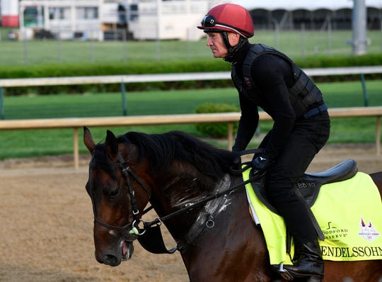 An exercise rider works Kentucky Derby entry Mendelssohn at Churchill Downs.