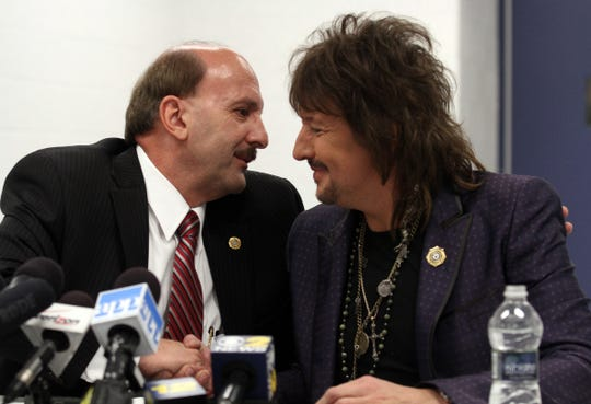 Ocean County Prosecutor Joseph D. Coronato (left) is shown with musician Richie Sambora before a forum held in Toms River, NJ, Tuesday night, May 27, 2014.    TOMS RIVER, NJ   DRUGFORUM0527A  ASB 0528 HEROIN FORUM  WITH VIDEO  STAFF PHOTO BY THOMAS P. COSTELLO / ASBURY PARK PRESS