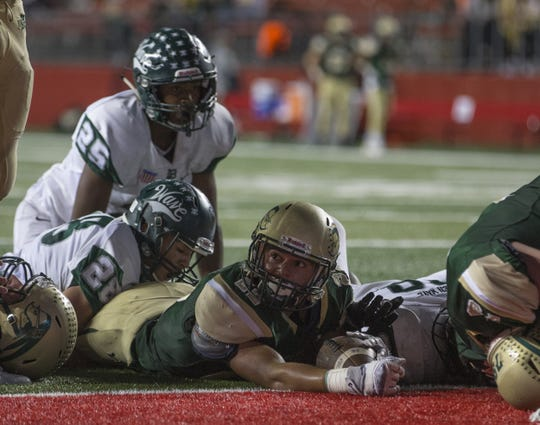 Red Bank Catholic and Long Branch, shown during last year's meeting at Rutgers, will play again this Friday in Red Bank.