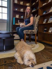 Owner Lisa Purcell and her dog Chewy of Art Paper Scissors in Farmingdale.