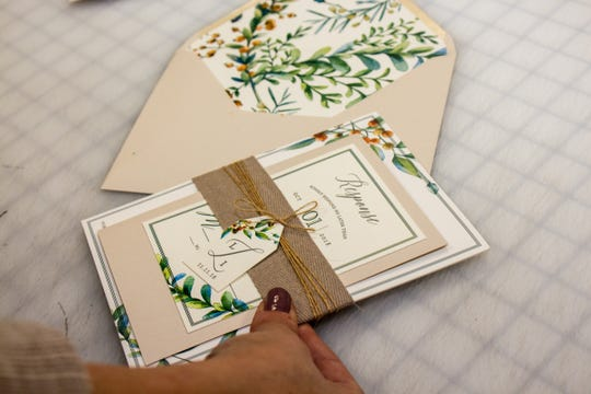 Samples of invitations designed by owner Lisa Purcell of Art Paper Scissors in Farmingdale