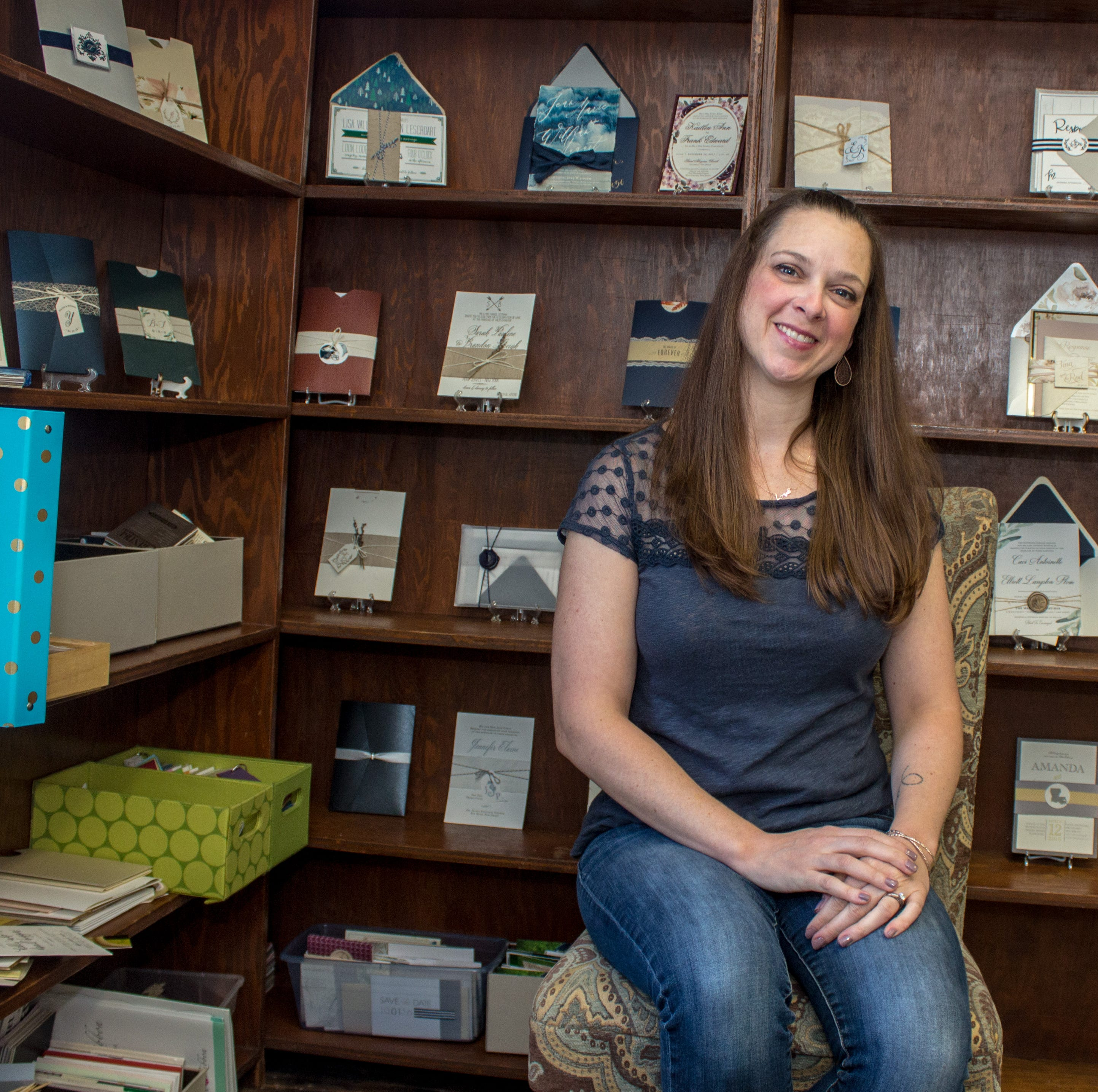 Farmingdale wedding invitation maker gets to work with customers in love