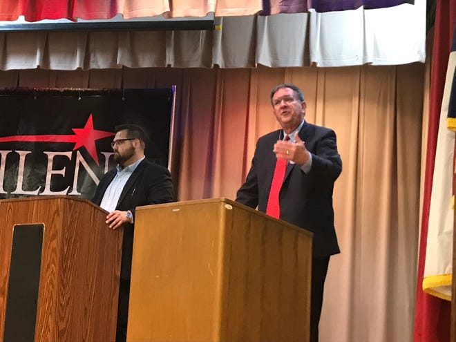 State Rep. Stan Lambert, right, addresses a crowd at the Abilene Public Library's downtown branch during a candidate forum event presented by the Abilene Chamber of Commerce on Monday. Lambert's challenger, Democrat Sam Hatton, left, listens.