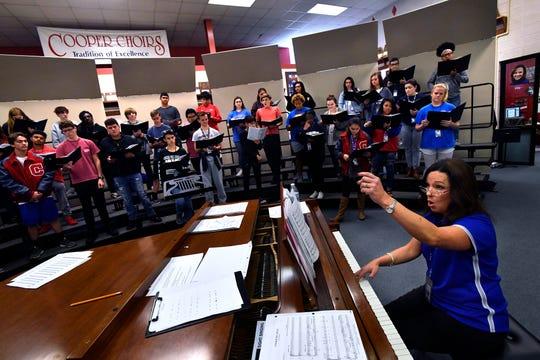 Cara Naizer leads the Cooper High School choir during rehearsal.
